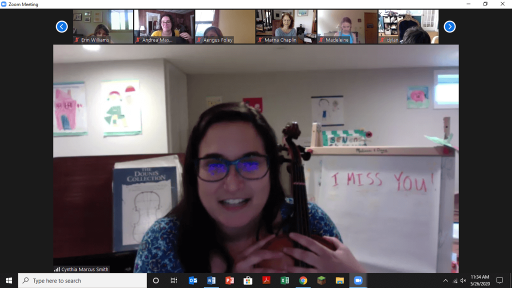 Violinist in screenshot on a live stream into a classroom