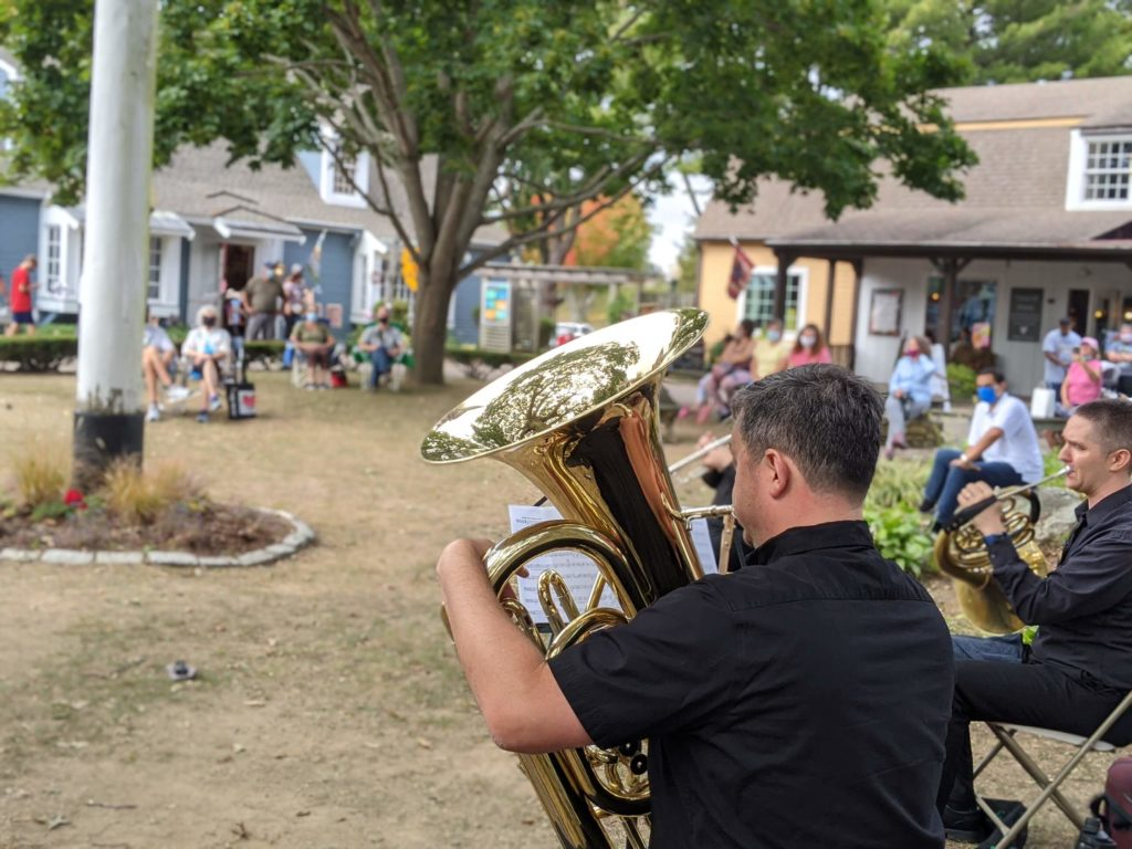 Close-up of tuba player performing outdoors